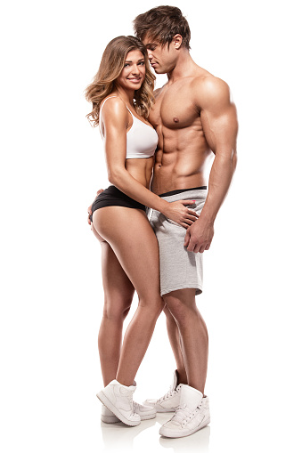 sexy couple, muscular man holding a beautiful woman