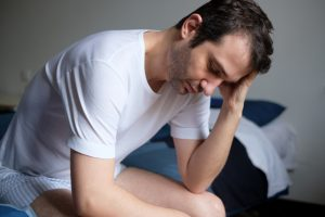 sad man with erectile dysfunction with arthritic gout