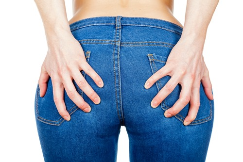 woman in jeans holding both ass cheeks