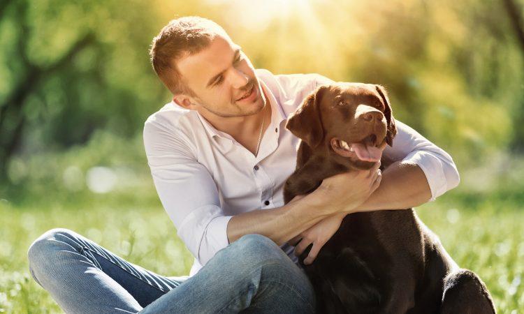 happy man hugging his dog