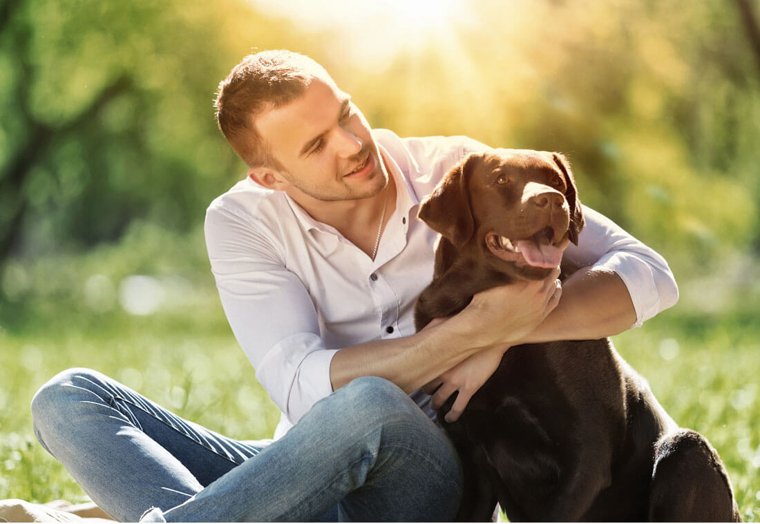happy man hugging his dog