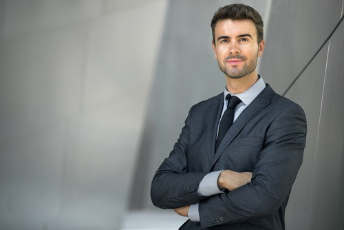 successful and healthy businessman crossing arms