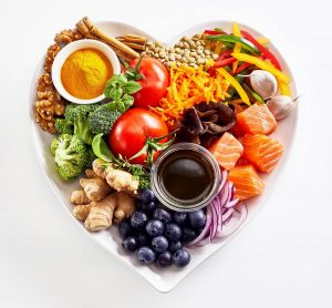 heart healthy food in heart-shaped plate