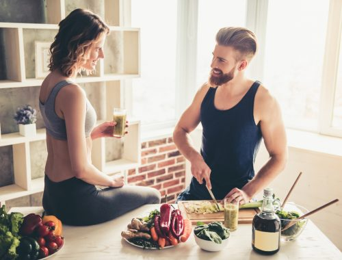 healthy couple who enjoys Progentra preparing nutritious meal