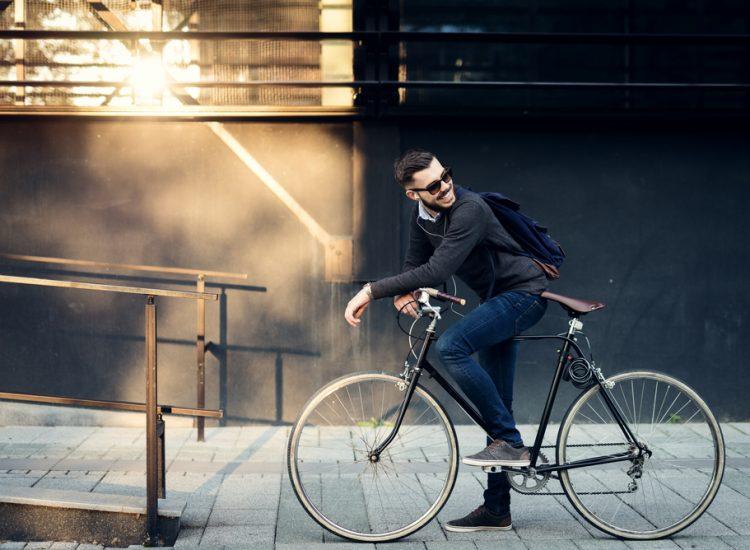 man on his bike going to work and happy about Progentra
