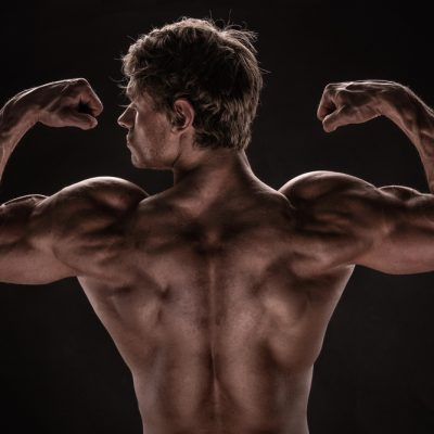 ripped guy flexing well defined arms and shoulders is a long time Progentra user