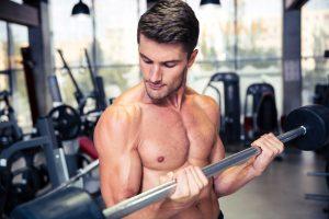 buff guy lifting weights