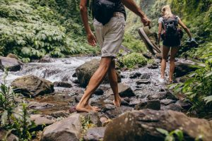 hiking barefoot by the river