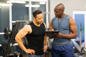 personal trainer coaching a man