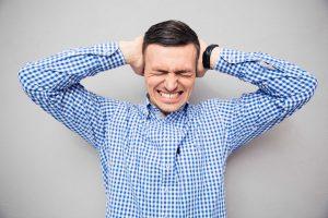 man suffers ear pain